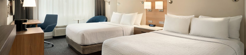 Two double beds in hotel guestroom