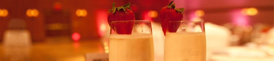 Champagne glasses, strawberry garnish